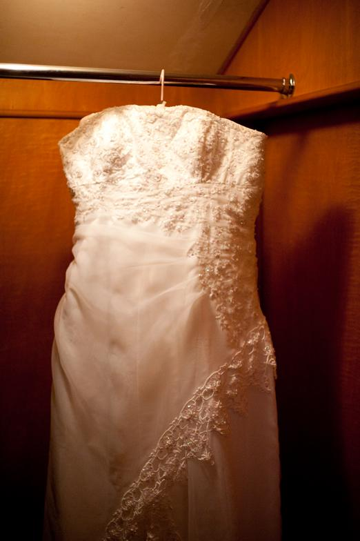 Custom designed wedding dress with more than 20,000 hand sewn crystals, beads and sequence.