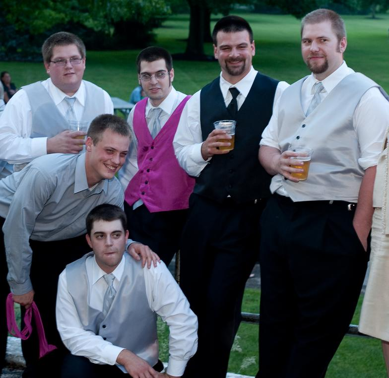 Vests for groomsmen to match bridesmaid's dresses.